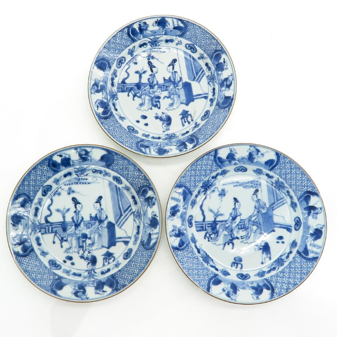 A Series of Three Blue and White Decor Plates