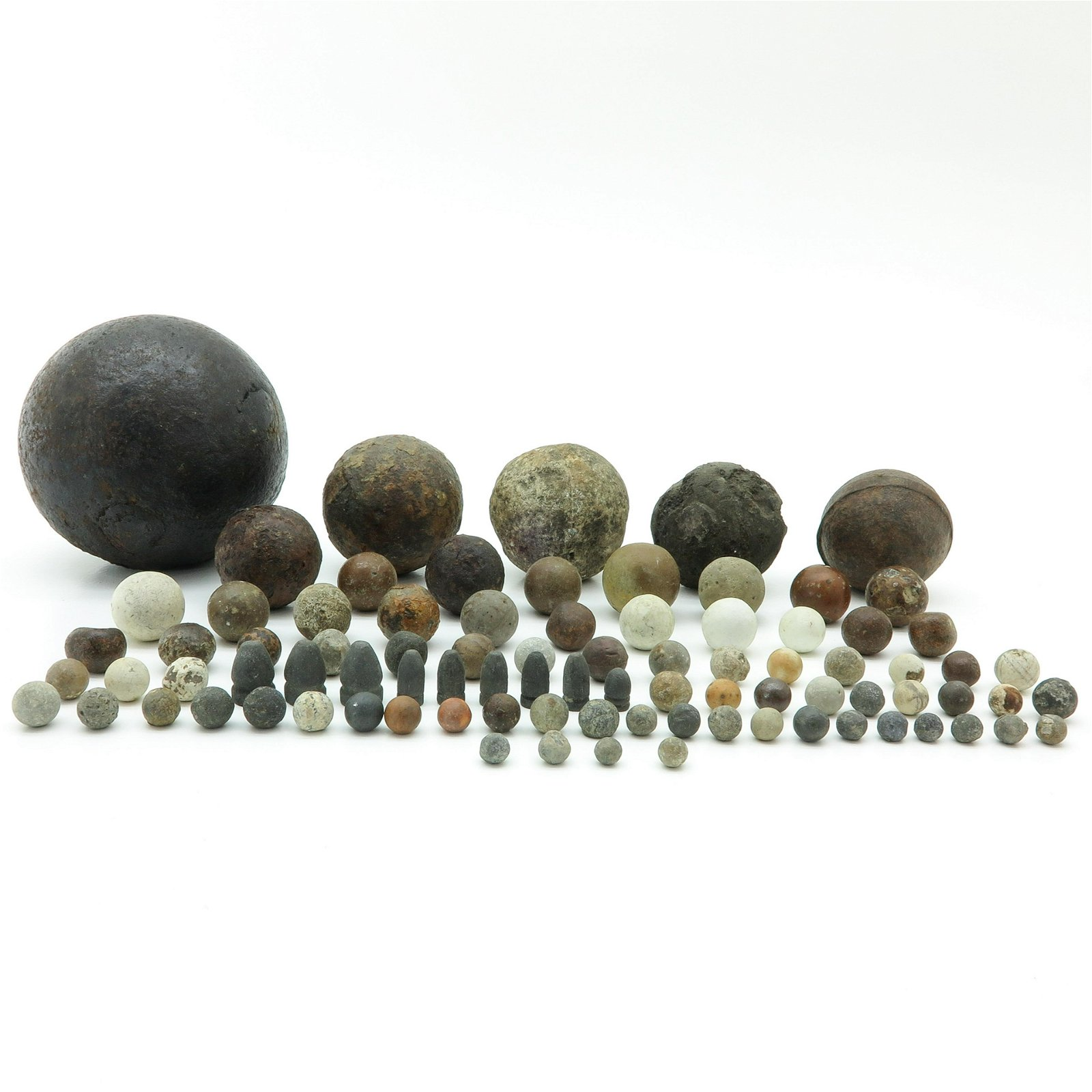 A Diverse Collection of Antique Iron Bullets