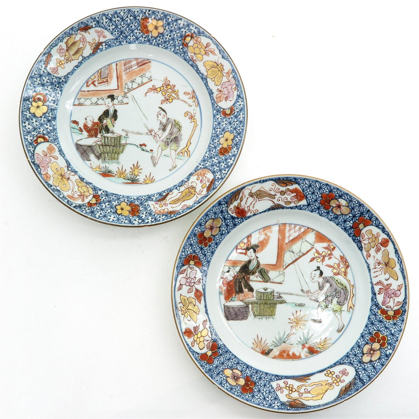 A Pair of Polychrome and Gilt Decor Plates
