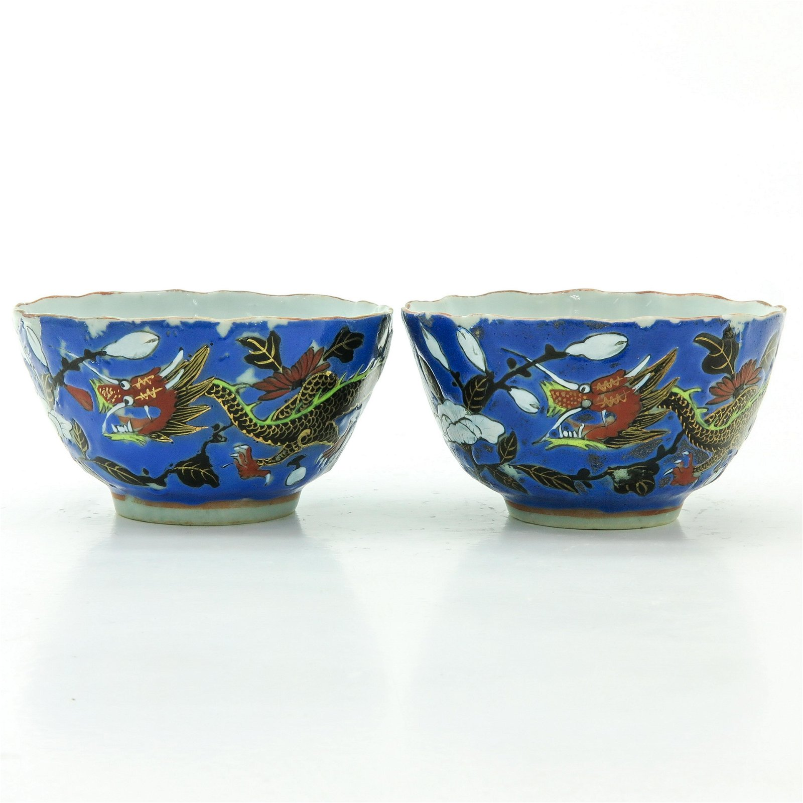 A Pair of Polychrome Decor Cups