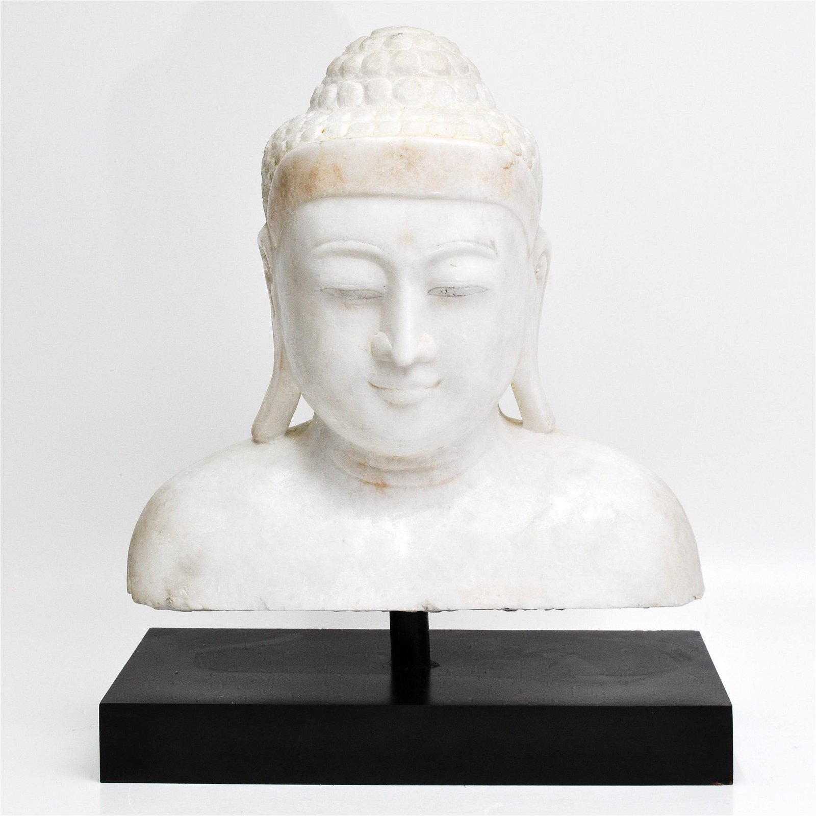 A Carved Marble Buddha Bust