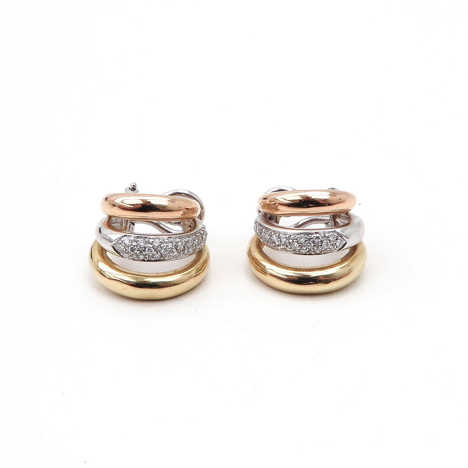 A Pair of 18KG Diamond Earrings