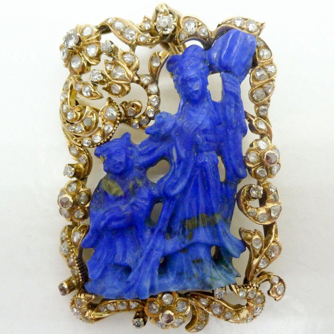 A Fine Carved Lapis Lazuli Brooch with Diamonds 14KG