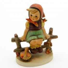Hummel Figurine Girl Sitting On Fence With Basket