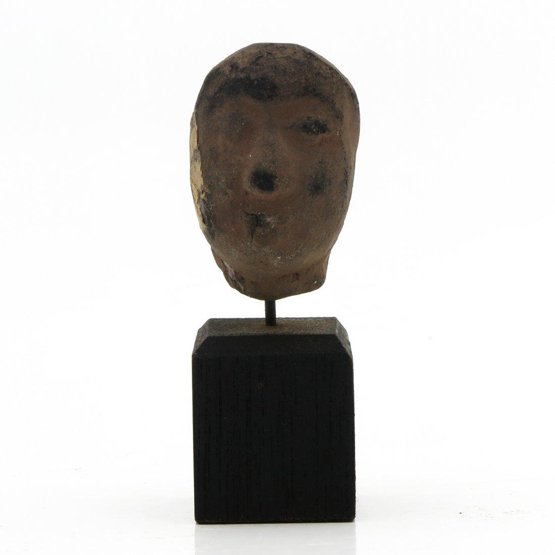 Sculpture Depicting Head