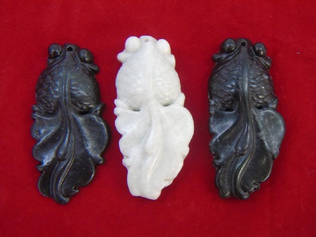 Three Carved Chinese Hardstone Koi Fish Pendants