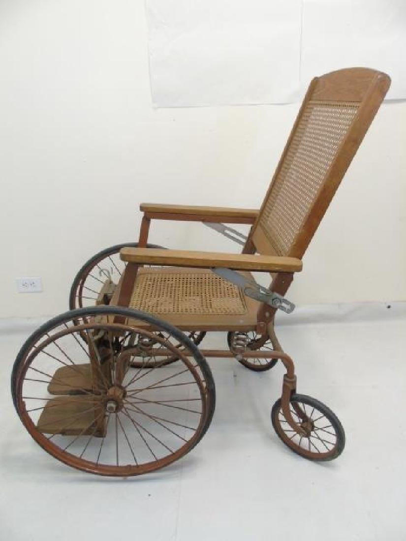 Antique Wood Framed & Cane-Seat Wheelchair