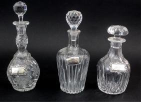 3 Cut Glass Liquor Decanters With Faceted Stoppers