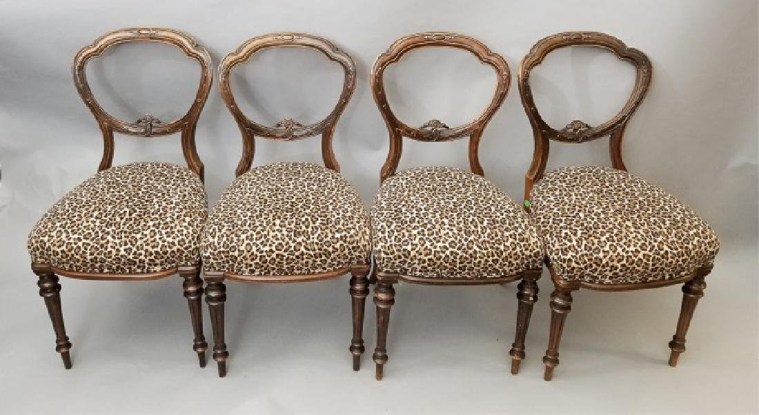 4 Wood Chairs with Leopard Upholstered Cushions