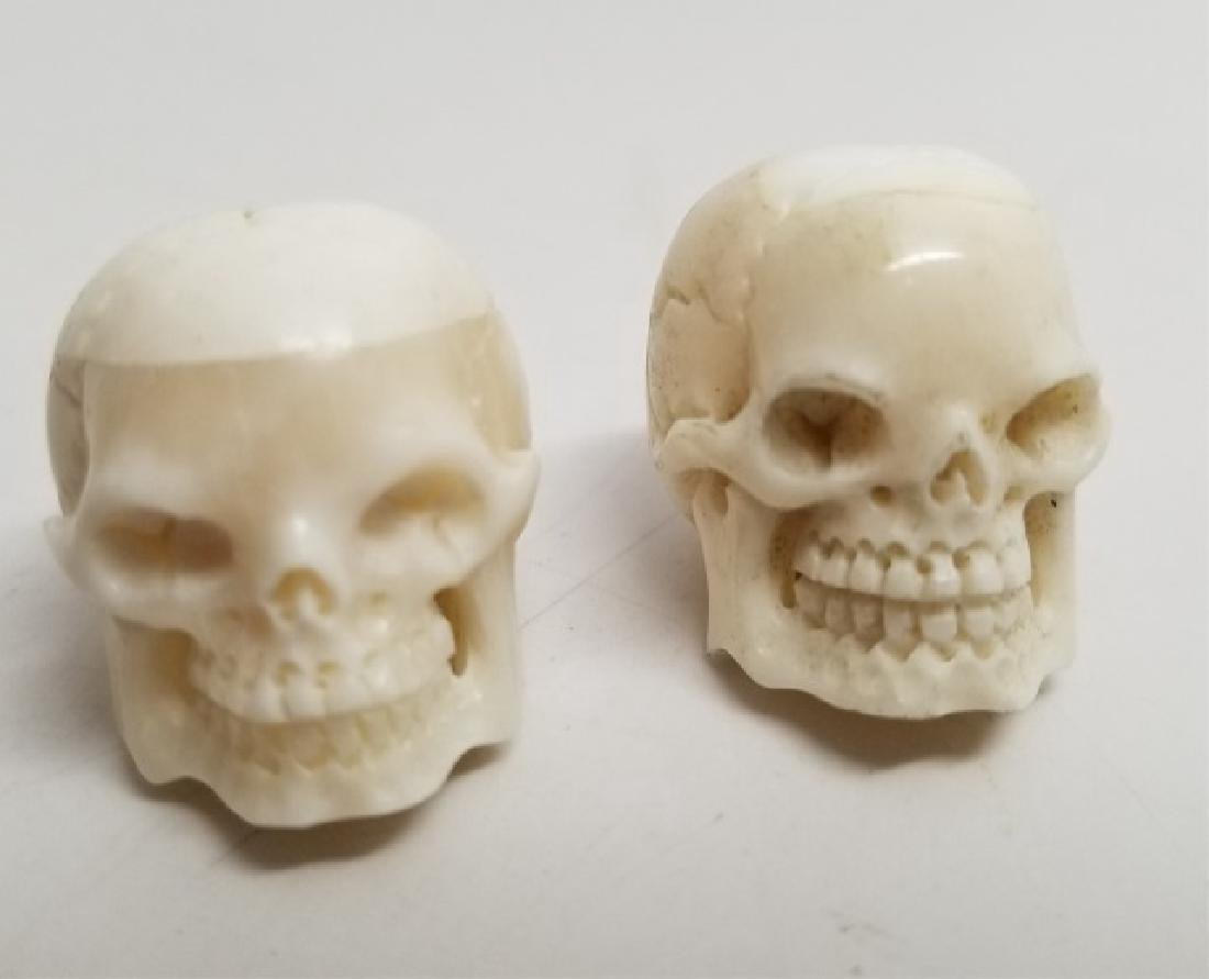 Pair Carved Bone Detail Memento Mori Skull Pendant
