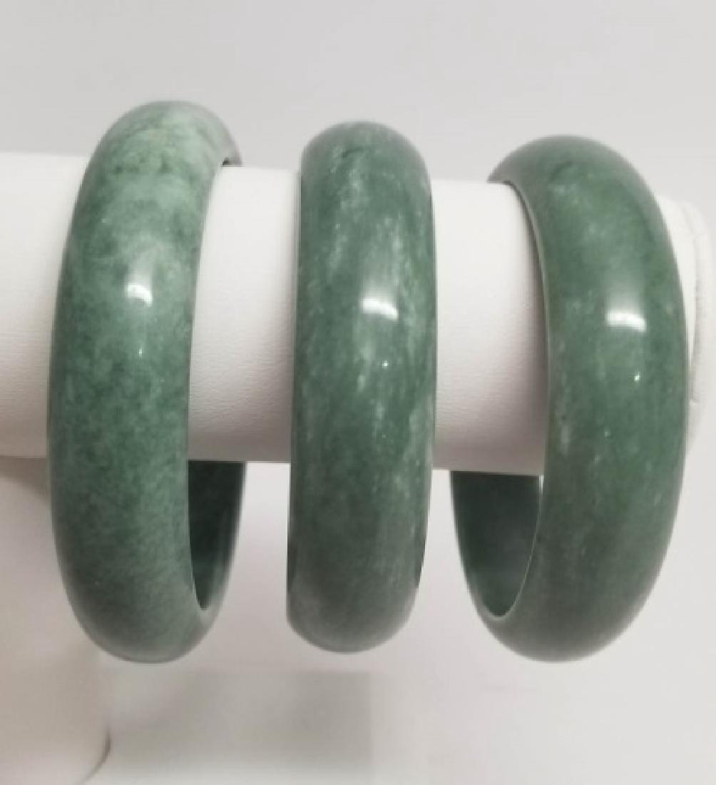 Three Carved Chinese Jade or Hardstone Bangles