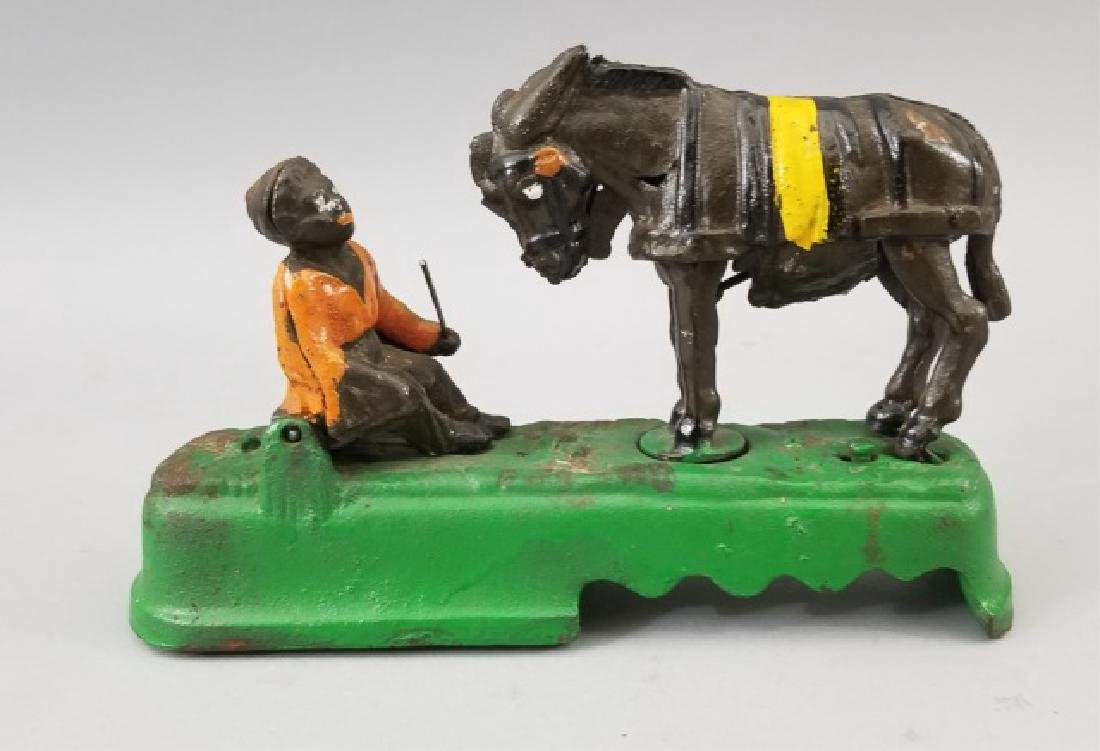 Older Painted Iron Mechanical Bank Bucking Horse