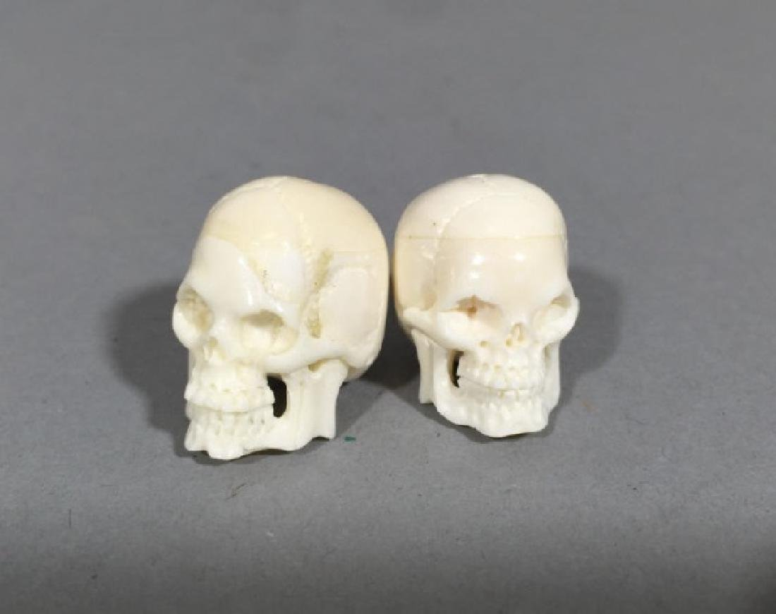 Pair Carved Bone Detail Memento Mori Skulls