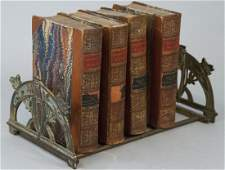 Four Antique Books Plus Antique Book Stand