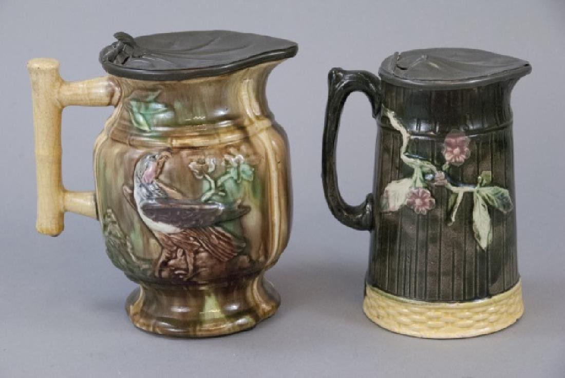 Two Majolica Water Pitchers W/ Tin Tops