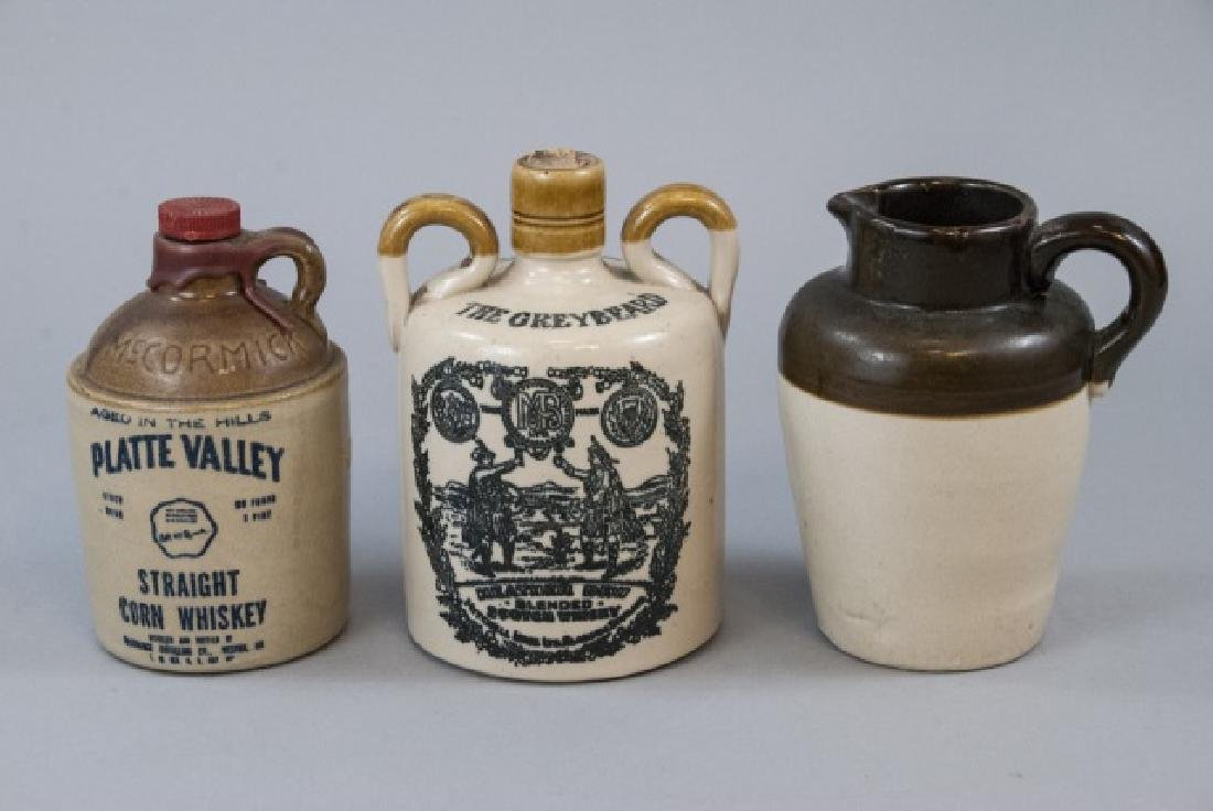 Three Stoneware Commercial Pitchers & Jugs
