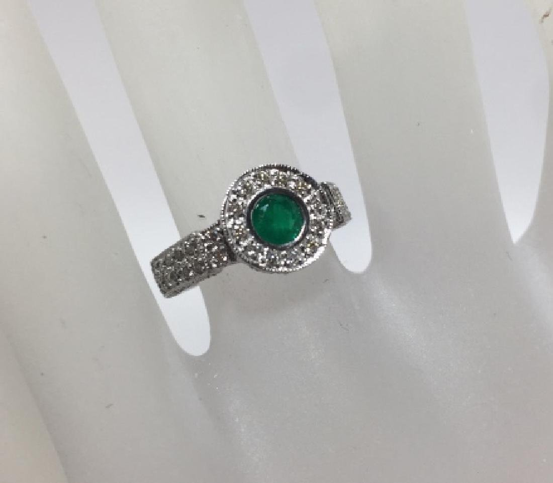 18kt White Gold Emerald & Diamond Halo Ring