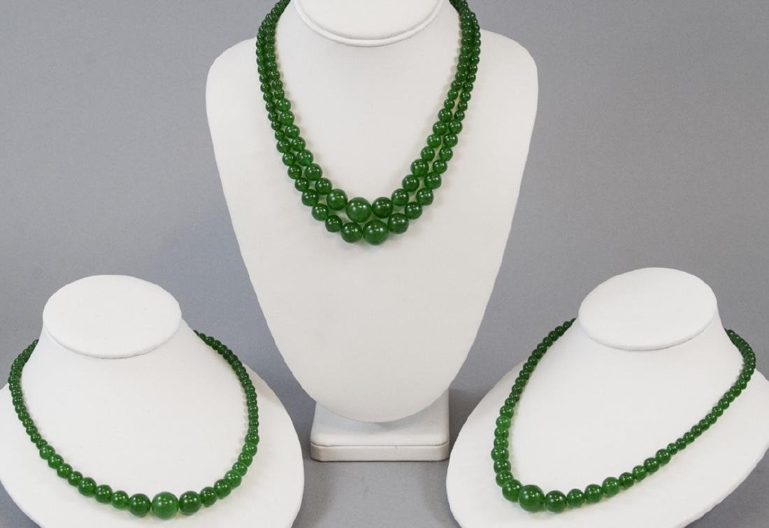 Four Chinese Green Graduated Jade Bead Necklaces