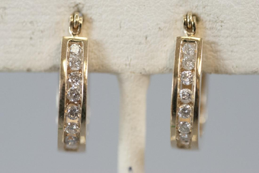 Pair 14kt Yellow Gold Channel Set Diamond Earrings