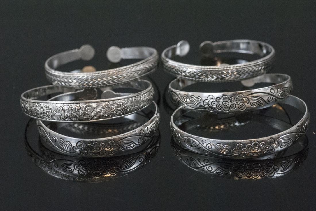 Group of Six Silver Tone Chinese Cuff Bracelets