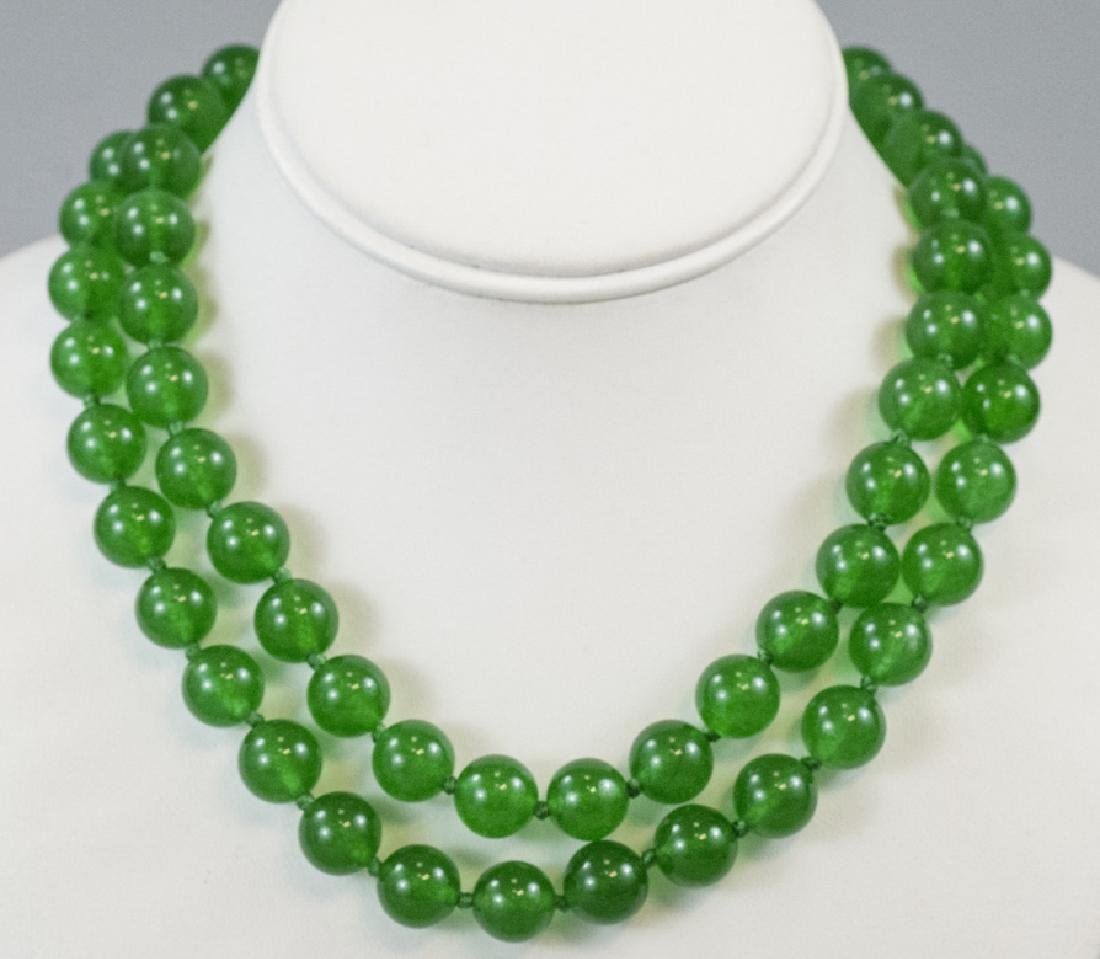 Pair of Carved Green Jade Necklace Strands