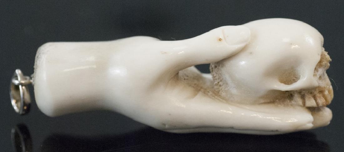Hand Carved Horn Pendant - Hand Holding Skull