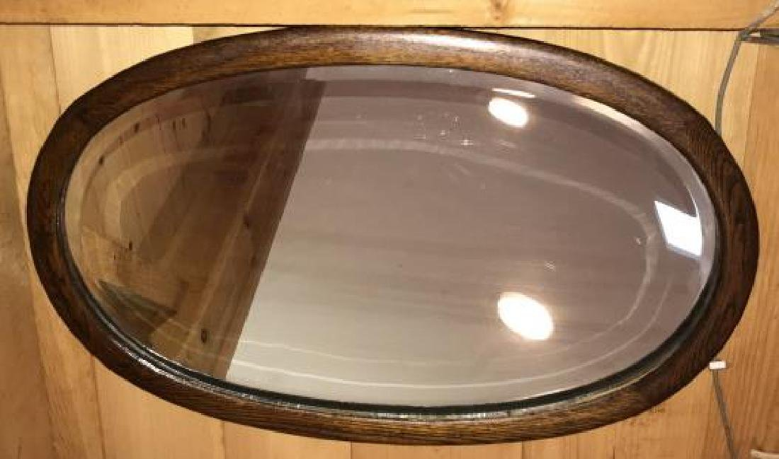 Carved Antique Oval Frame Beveled Glass Mirror