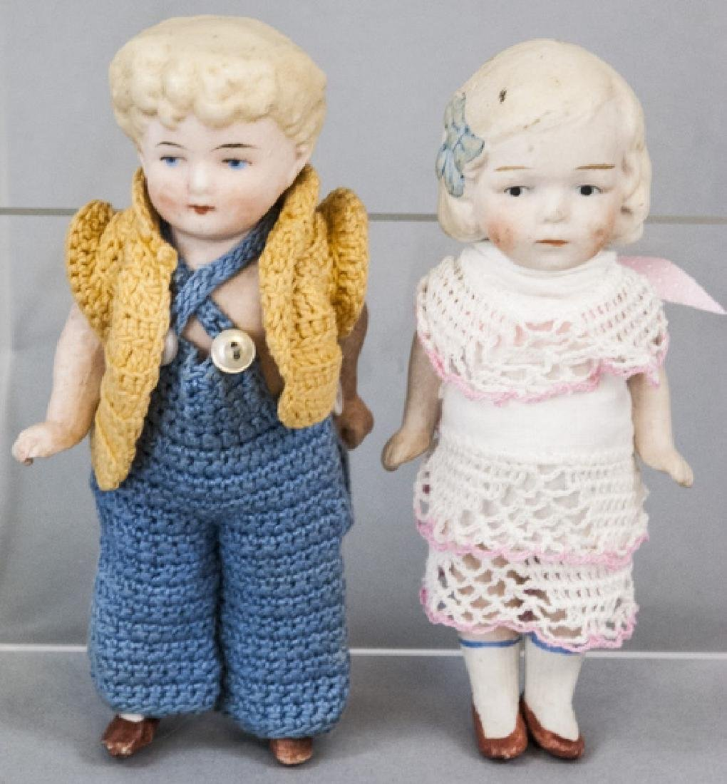 Two Antique All Bisque German Dolls w Clothes