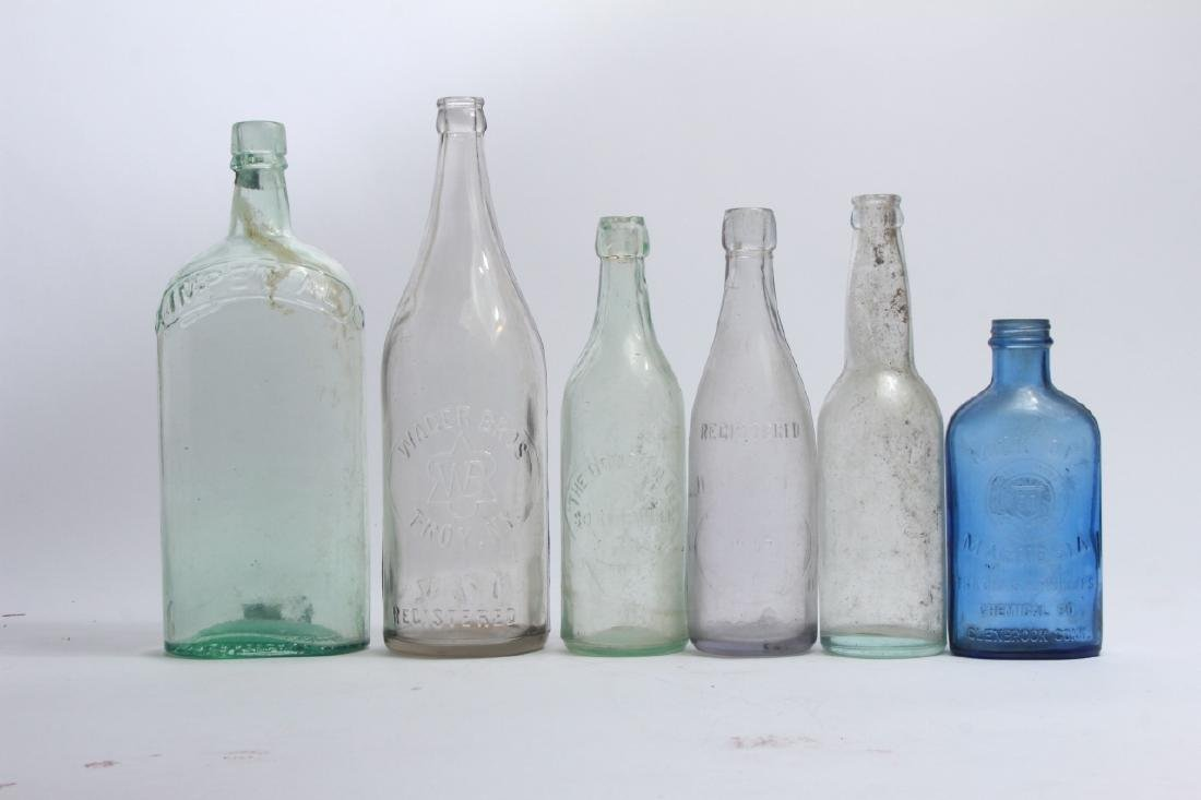 Collection of Antique Glass Bottles w Green Basket - 3