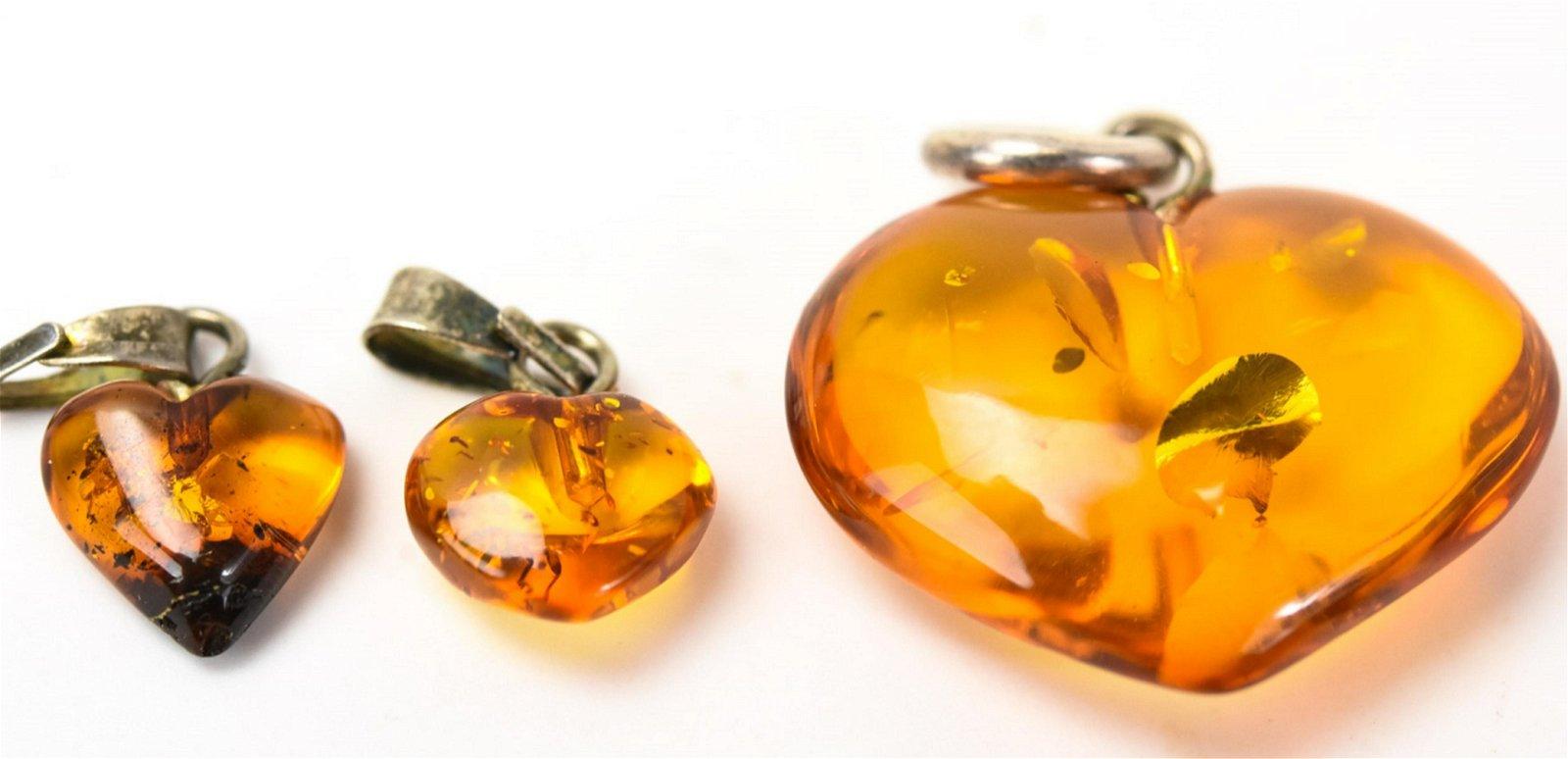 Three Vintage Sterling & Amber Heart Form Pendants