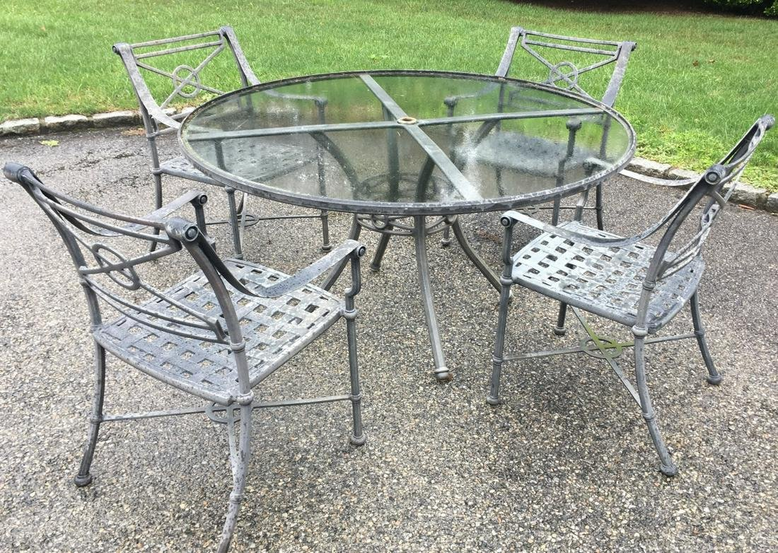 4 Outdoor Arm Chairs & Glass Top Dining Table