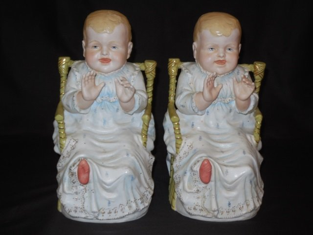 Pair of Bisque Painted Piano Baby Statues