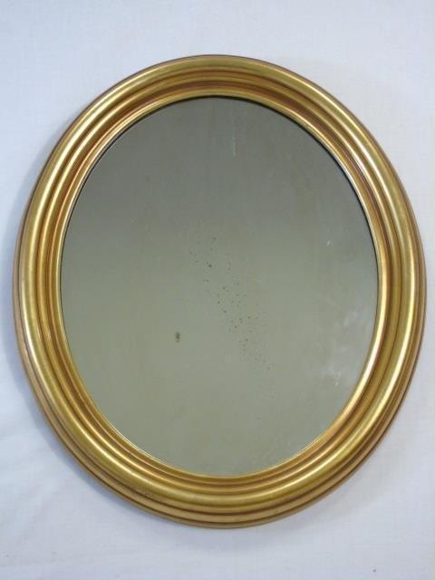 Carved Oval Gold Leaf Framed Mirror
