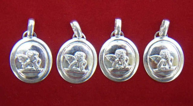 Four Sterling Silver Pendants w Cupids