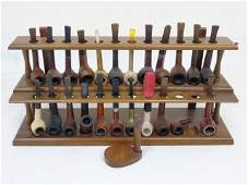 Collection of Vintage Pipes on Wooden Stand