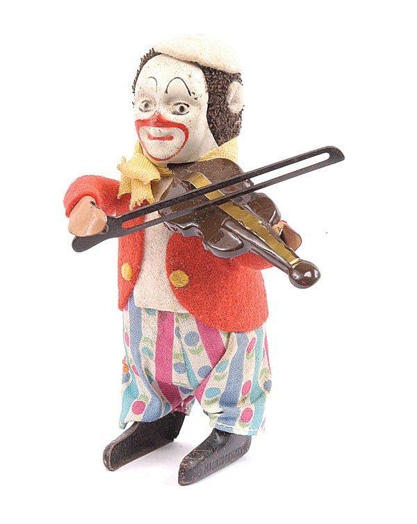 1008: Schuco - 986/2 - Clockwork Clown Violinist
