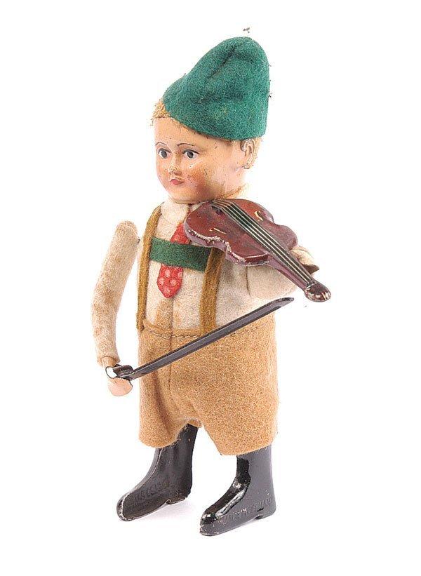 1011: Schuco - 982/2 Clockwork Bavarian Boy Violinist.