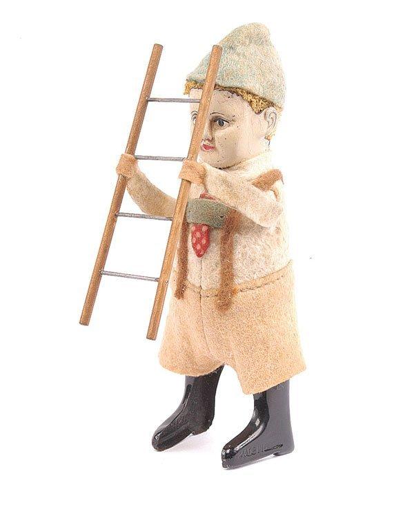 1012: Schuco 982/7 Clockwork Bavarian Boy with Ladder
