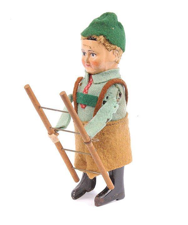 1014: Schuco 982/7 Clockwork Bavarian Boy with Ladder