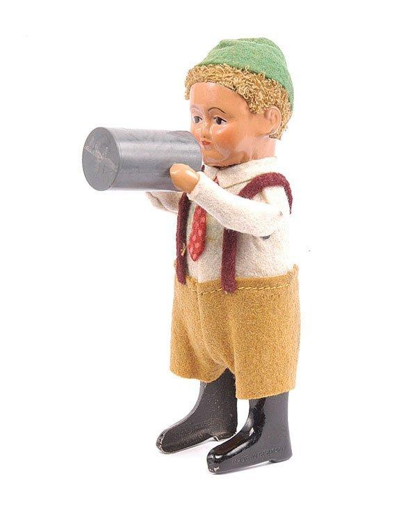 1015: Schuco 982/6 Clockwork Bavarian Boy with Stein