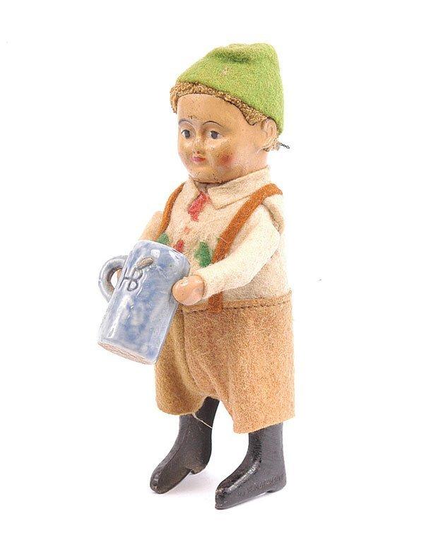 1018: Schuco 986/2 Clockwork Bavarian Boy with Stein