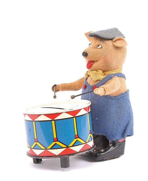 1024: Schuco - 980/5 Clockwork Pig with Drum Money Box
