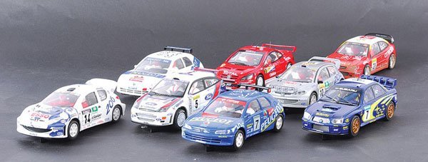 1241: Ninco, SCX, Scalextric - A Group of Rally Cars