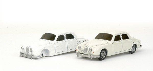 4020: Corgi Classics pair of pre-pro resin Jaguars