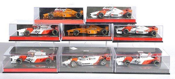 7: Minichamps - A Group of McLaren F1 Cars
