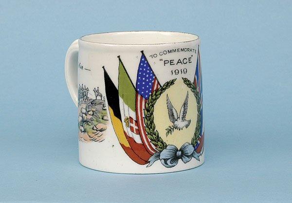 624: Transfer printed china mug [dia 2.5 ins] ca 1919