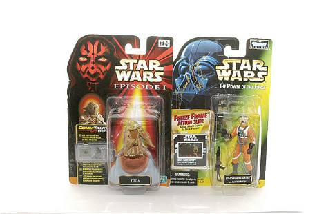 A pair of signed Star Wars action figures