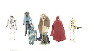 A collection of loose Star Wars action figures