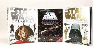 A group of Star Wars books and calendars