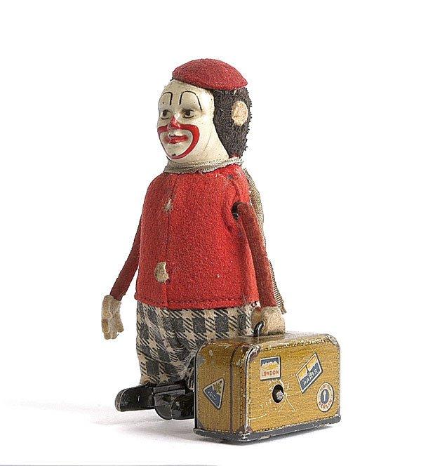 7: Schuco - 786 - Clown with Suitcase